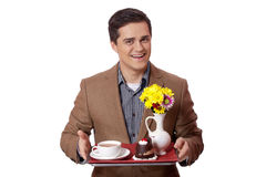 Man in suit holding tray with sweet breakfast Stock Image