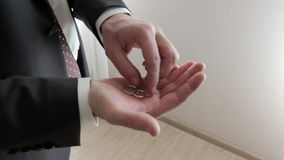 Man in a suit holding a two wedding rings stock video footage