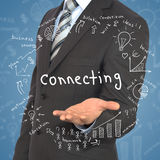 Man in suit holding word. Connecting. Around fly business sketches Stock Images