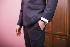 Man in suit, holds hand in pocket. Royalty Free Stock Photos