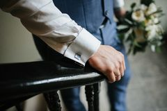 A man in a suit holds a wedding bouquet of flowers close up royalty free stock photos