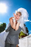 Man in suit kidnapping screaming bride Royalty Free Stock Image