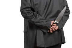 Man in suit with large knife Royalty Free Stock Images