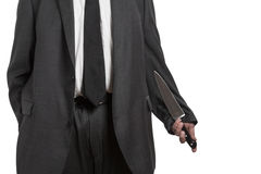 Man in suit with large knife Stock Image