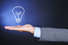 Man in suit with a lightbulb in his hand Stock Photo