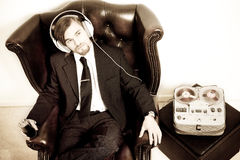 Man in a suit  listen to the music Royalty Free Stock Image