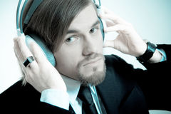 Man in a suit  listen to the music Stock Image
