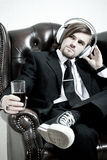 Man in a suit  listen to the music Royalty Free Stock Photos