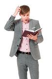 Man in suit looking very shocked with notepad Royalty Free Stock Photos
