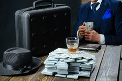 Man in suit. Mafia. Making money. Money transaction. Businessman work in accountant office. Small business concept. Economy and finance. Man bookkeeper. New royalty free stock images