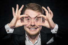 Man in suit makes funny face Stock Images