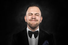 Man in suit makes funny face Stock Photo