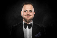Man in suit makes funny face Stock Photography