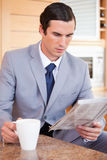 Man in suit making breakfast Royalty Free Stock Image