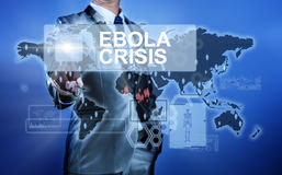Man in suit making decision on ebola crisis. With world map Royalty Free Stock Images
