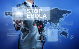 Man in suit making decision on stop ebola Stock Image