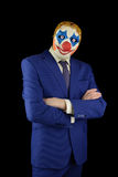 Man in a suit and mask of a clown Royalty Free Stock Image