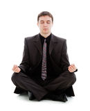 Man in a suit, meditate sitting on the floor. Royalty Free Stock Photos