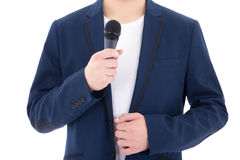 Man in suit with microphone isolated on white background Stock Photography