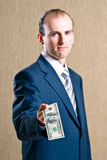 A man in a suit with money Stock Photography