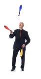 Man in suit multitasking. Man in suit juggling concept of multitasking Royalty Free Stock Photo