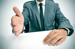 Man in suit offering to shake hands Royalty Free Stock Photography
