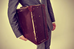 Man in suit with an old suitcase Stock Photography