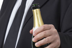 Man in suit with open Champagne bottle Stock Image