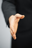 Man in suit with an open hand Stock Photography
