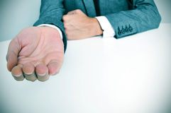 Man in suit with an outstretched hand Stock Photo