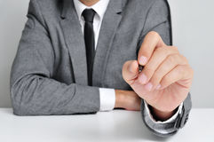 Man in suit with a pen Stock Photography
