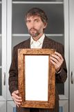 Man in suit with picture. In old frame Royalty Free Stock Photos