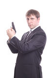 The man in a suit with a pistol Stock Photos