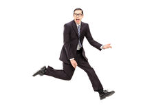 Man in suit playing air guitar Stock Image