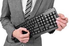 Man in suit playing a computer keyboard Royalty Free Stock Photo