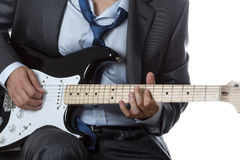 Man in suit playing electric guitar isolated on white Royalty Free Stock Photo