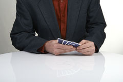 Man in suit playing poker Royalty Free Stock Photo