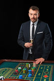 Man in suit playing roulette. addiction to gambling. stock images