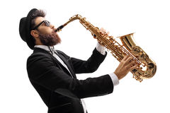 Man in a suit playing on a saxophone Stock Photos