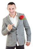 Man in suit pointing at rose in his pocket Stock Image