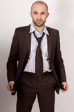 Man with suit is poor. He has empty pockets royalty free stock images