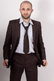 Man with suit is poor. She has empty pockets stock photo
