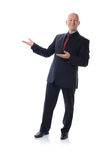 Man in suit presenting. Buisiness man presenting to copy space Royalty Free Stock Photography