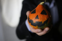 Man in suit with pumpkin Royalty Free Stock Photography