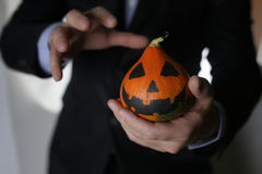 Man in suit with pumpkin Stock Photos