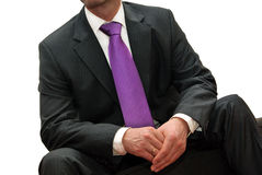 Man in suit with purple tie. Businessman in suit with purple tie isolated on white Royalty Free Stock Images
