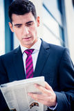 Man in suit reading newspaper Royalty Free Stock Photos