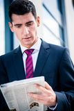 Man in suit reading newspaper royalty free stock photo