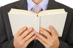 Man in suit reads book Stock Images
