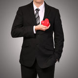 Man in suit with red heart. Valentine's Day Royalty Free Stock Photos